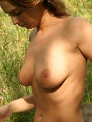 Pictures of Abrianna flashing her tits outside