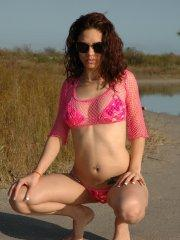Pictures of teen star Alex Jolie taking off her pants outside