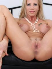 Busty blonde Lara De Santis nude and spreading her legs