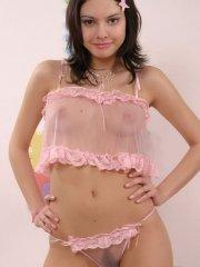 Pictures of teen cutie Banana Brandy slipping out of her pink lingerie just for