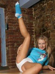 Pictures of Courtney Lightspeed teasing in panties and socks