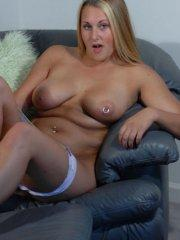 Pictures of Courtney Virgin exposing her body on the couch