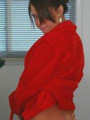 Emily stips out of her red robe