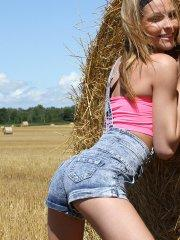 Pictures of Fuckable Lola getting naked on the farm