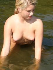 Vicky naked taking a bath in a lake