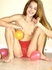 Pictures of teen Jenny Heart playing with balloons