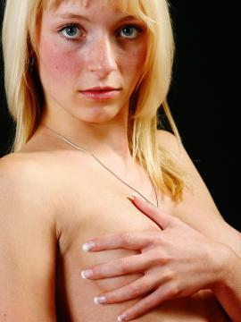 Pictures of blonde Coed Justine stripping in the studio