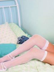 Pictures of Kara's Handfull in fishnet stockings and heels