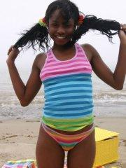 Pictures of ebony teen Kiss Promise flashing on a beach