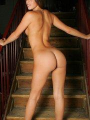Pictures of Lacey Alexandra wearing only her heels on the stairs