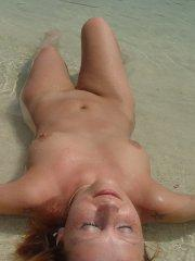 Pictures of Lindsey Marshal all naked on a beach