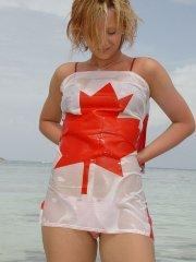 Pictures of teen chick Lindsey Marshal wrapped up in a Canadian flag on the beac