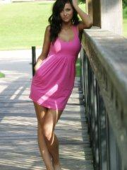 Pictures of teen girl London Hart teasing in a pink dress