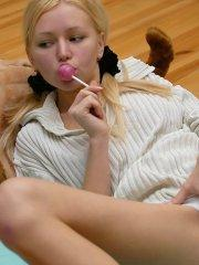Naked Anne licking a lollipop in pigtails and socks