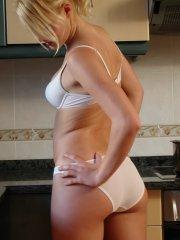 Pictures of Lovely Lizzy showing her sexy ass in the kitchen