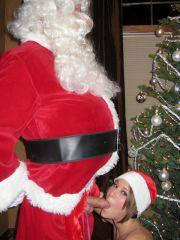 Pictures of Melissa Midwest getting her present from Santa Clause