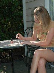 Pictures of My Wife Ashley getting naked in the back yard