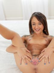 Hot 19 year-old Holly Hendrix gets naked and spreads her pussy