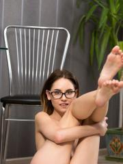 Brunette coed Sade Mare strips down to only her glasses