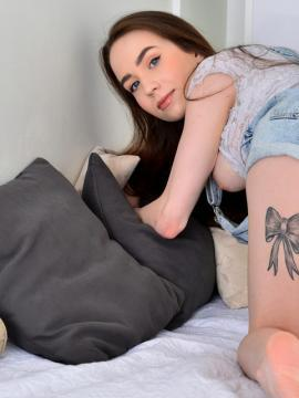 Redhead teen Angel Rush plays with her pussy in bed