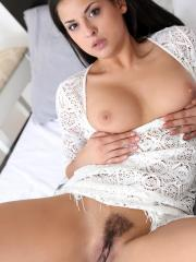 Brunette babe Coco De Mal gets naked and masturbates for you in bed