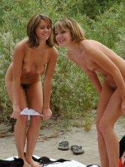 Pictures of 2 hot lesbian coeds on a beach