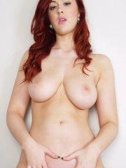 Pictures of Rosie Jaye playing with her hot redhead body