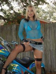 Pictures of Sandy Summers getting kinky with a motorcycle outside