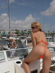 Pictures of Sandy Summers in a hot orange bikini