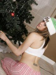 Pictures of Shaun\'s Slut waiting to open her xmas gifts