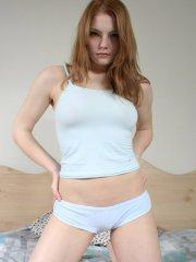 Pictures of teen babe Danielle waiting for you in bed
