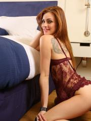 Beautiful redhead Taylor Wynn poses and teases in her burgundy lace