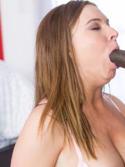 Busty brunette Tiff Banister loves black cock