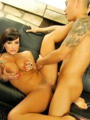Pictures of Lisa Ann enjoying a hard cock