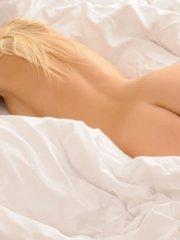 Pictures of a beautiful blonde girl completely naked in bed